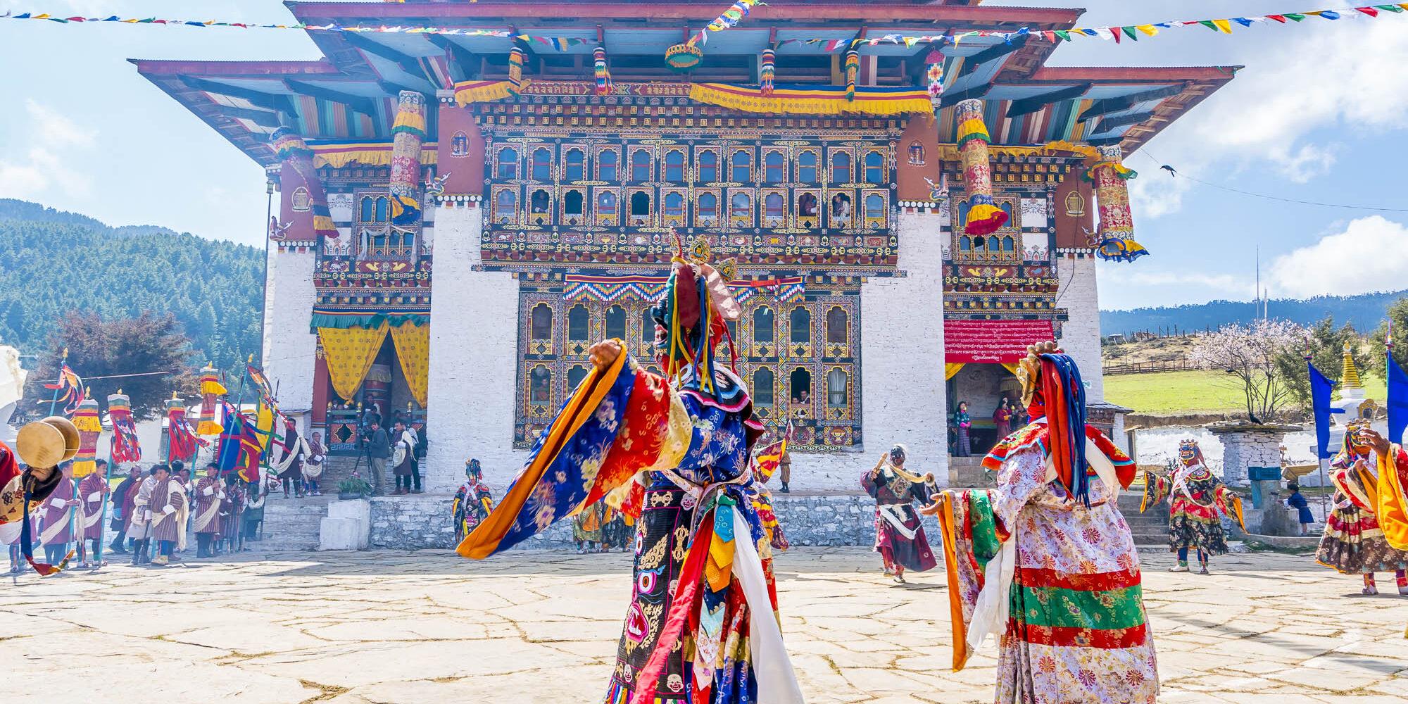Colorful Bhutan festival with dragon masks