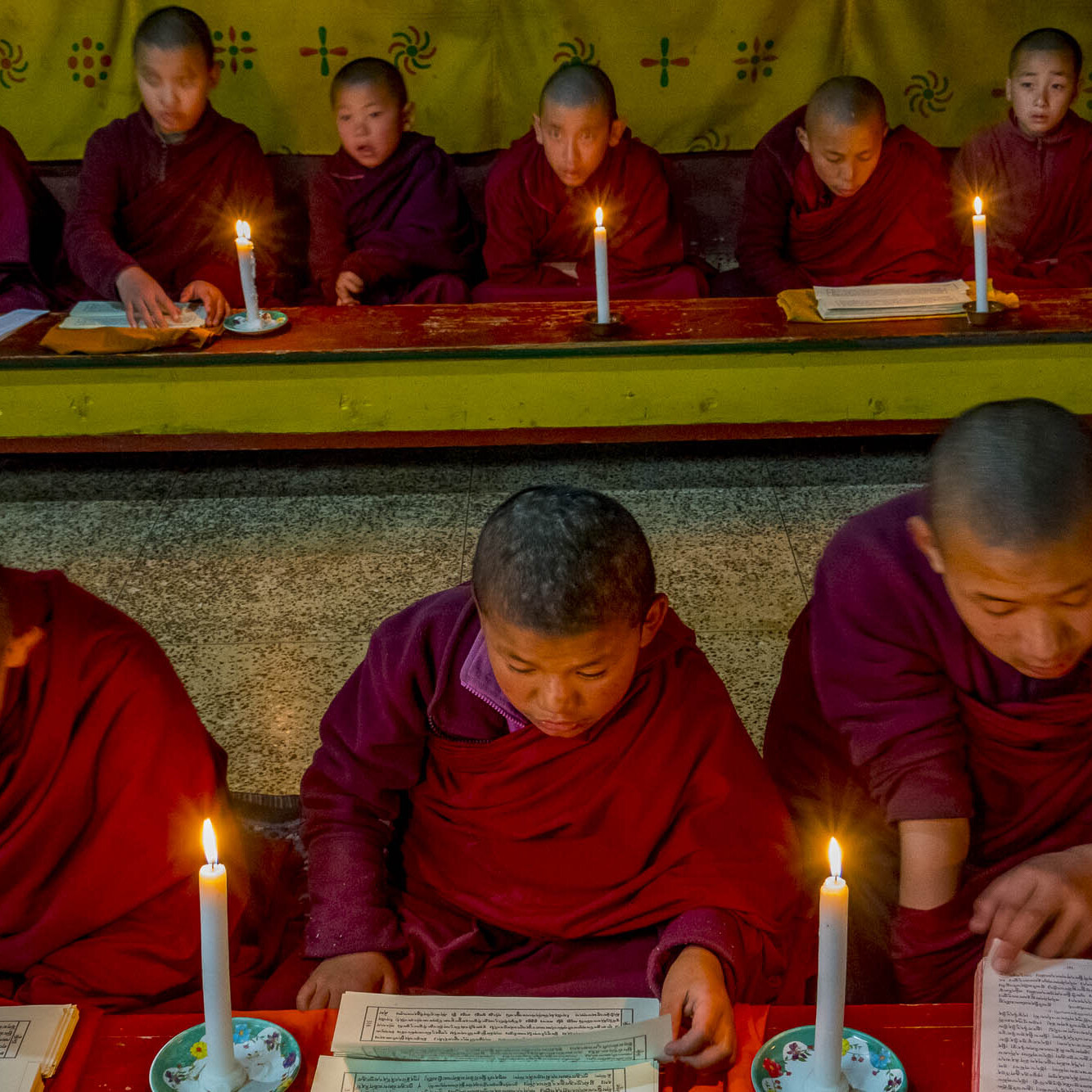Bhutanese monks study the holy writings