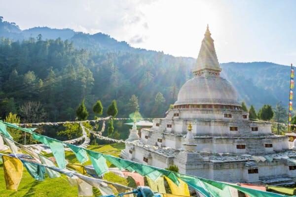 Sun shines over a Buddhist shrine in Bhutan