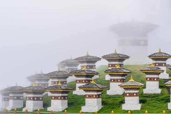many structures aligned in front of a Bhutanese temple