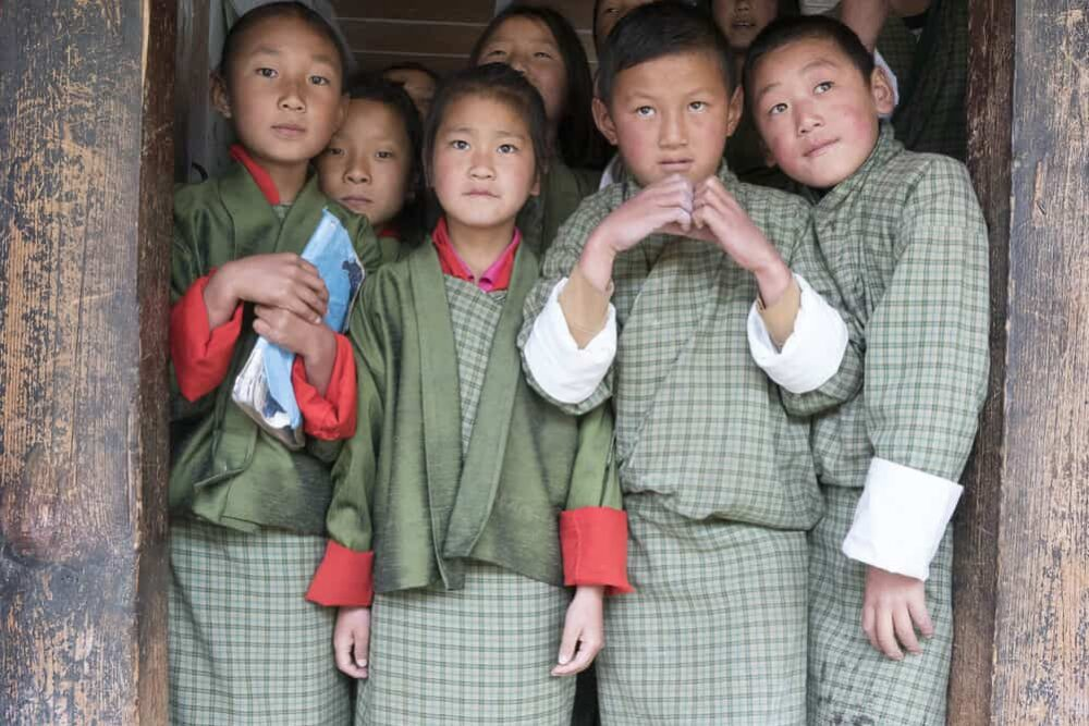 children in a doorway in Bhutan