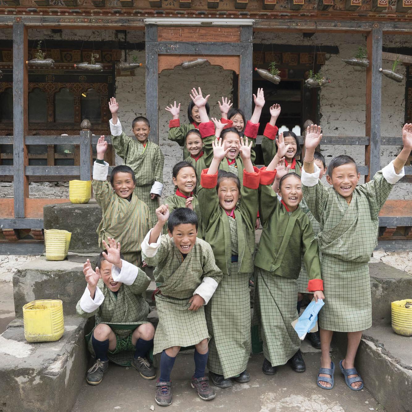 Bhutanese school children cheer with joy