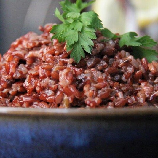 Red rice served with many dishes in Bhutan